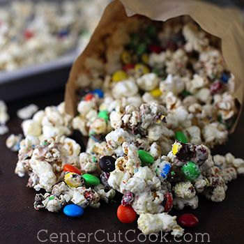 This White Chocolate Popcorn adorned with M's is like no other popcorn you've ever had! Salt, yet sweet. The combination of flavors is out of this World!