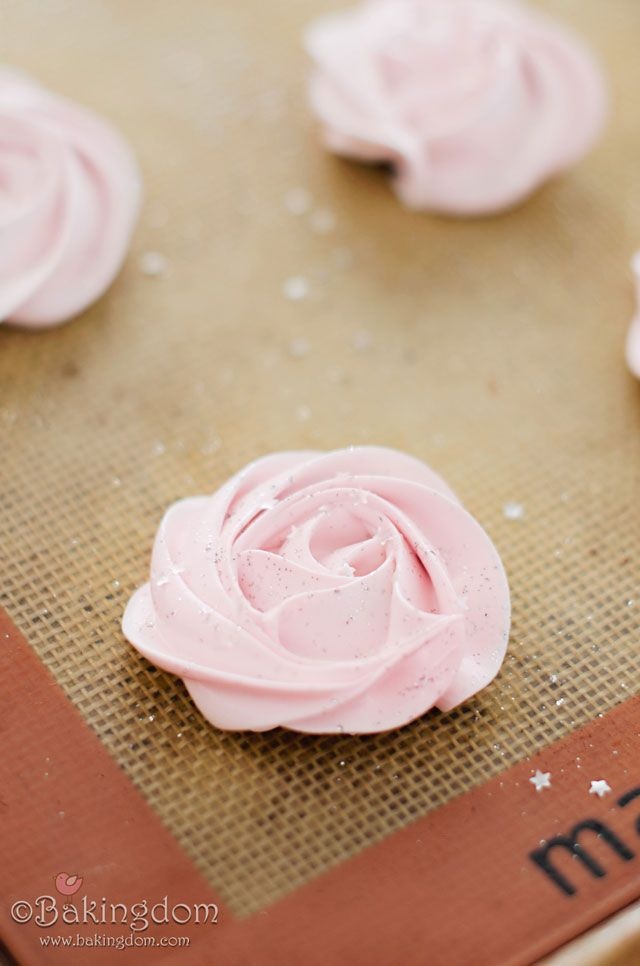 Chocolate Filled Raspberry Meringues, piped in a rose shape (tutorial link provided) colored in soft pink and sprinkled with silver disco dust and stars.