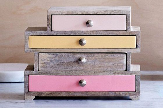 Each tipsy drawer in Oliver Bonas's mango-wood Betsy jewellery box is coloured in a different hue. £59; oliverbonas.com