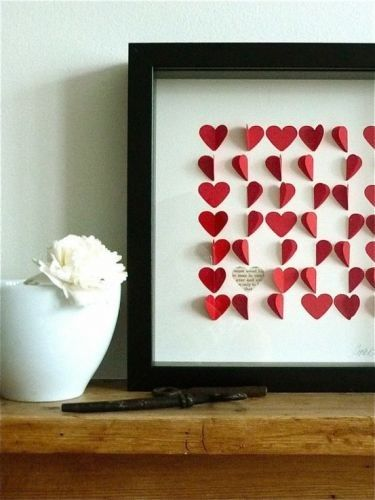 Create a chic work of art in a frame or shadow box. Cut hearts out of red construction paper and glue them onto a white background. Randomly tack some hearts fully on the paper, but leave others glued only on one side of the heart. The result is a fluttery flurry of red hearts!