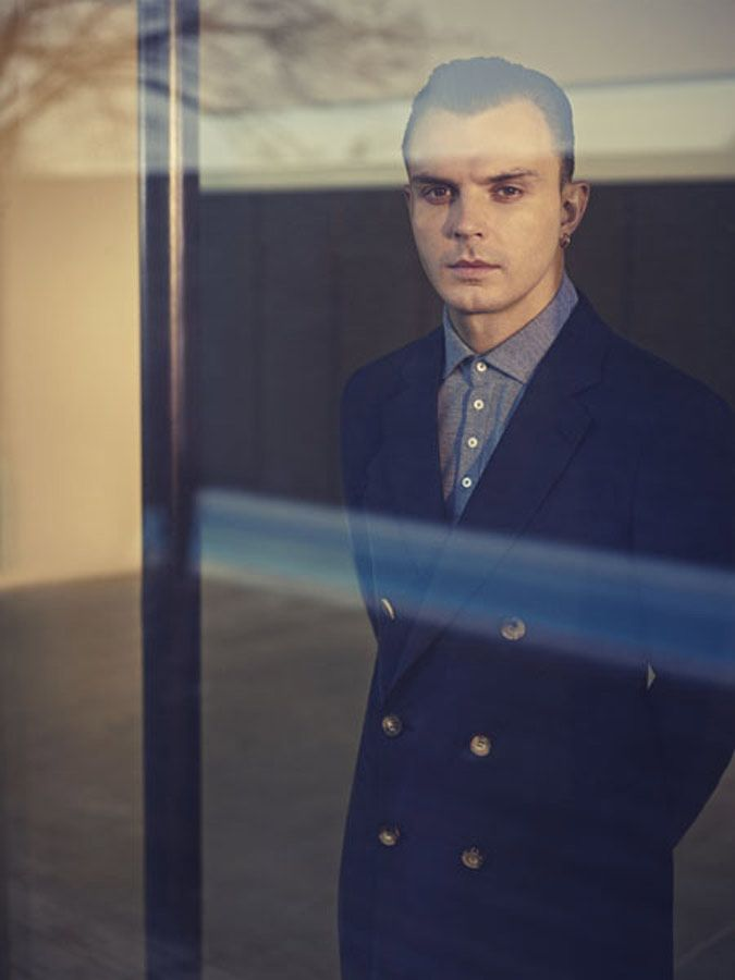 The Hurts frontman Theo Hutchcraft wearing an Emporio #Armani navy double-breasted cotton mix jacket and a blue Giorgio Armani cotton jersey polo shirt.