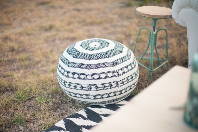 Monocrome ottoman and mint stool sidetable from a fresh, bright, modern outdoor intimate lounge Featured on paperandlace.com | Vintage Furniture Hire | www.borrowandbeau.co.nz | Styling: Borrow and Beau | Photography: PoppyMoss Photography | Rug: Collected by LeeAnn Yare