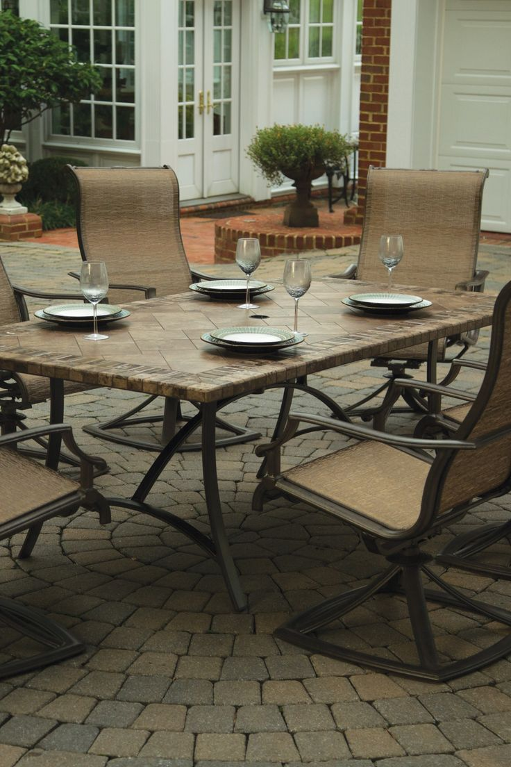 This Comfortable Centerpiece Outshines All Other Patio Sets With Four Swivel Rocker Chairs And A