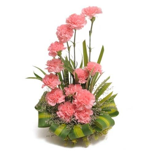 A buke of #flowers pretty pink carnations decorated with dracaena leaves  and green fillers. http://www.deliverfeelings.com/fresh-flowers.html