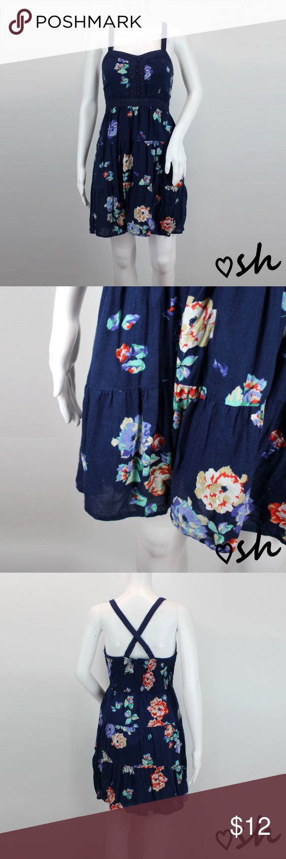 """American Eagle Navy Floral Cotton Sundress - Sz 4 Super cute and comfortable floral sundress from AEO.  It has a tiered skirt, faux buttons on the front, and elastic on the back.  It's made from 100% cotton, and partially lined.  Washing on the gentle cycle is recommended.  It's size 4; however, sizing can vary so please read measurements.  Armpit to armpit unstretched is 14"""" and shoulder to hem is 34"""".  It has been worn, and is a little pilly, but in overall good condition. American Eagle…"""