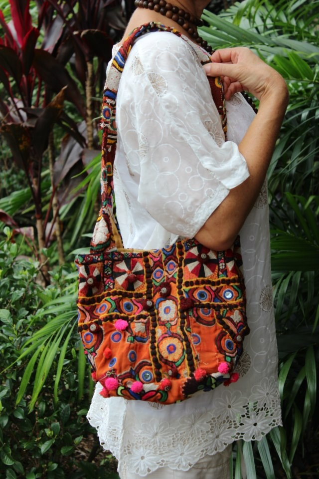 Liven up your day, carry a LALOOM Raja handbag..