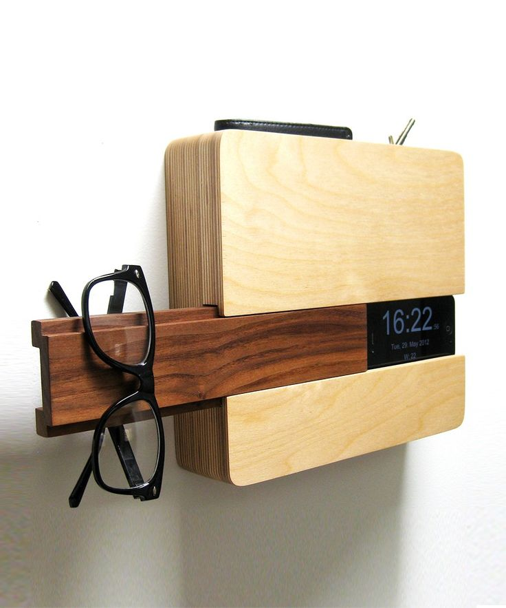 This modern-day butler will take your keys, wallet, and iPhone at the door.  Its wooden slide-out piece will even provide you with a place to hang your glasses, hat, or scarf. Almost better than a real butler, right?