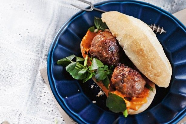Fill soft rolls with meatballs and a spicy almond sauce.