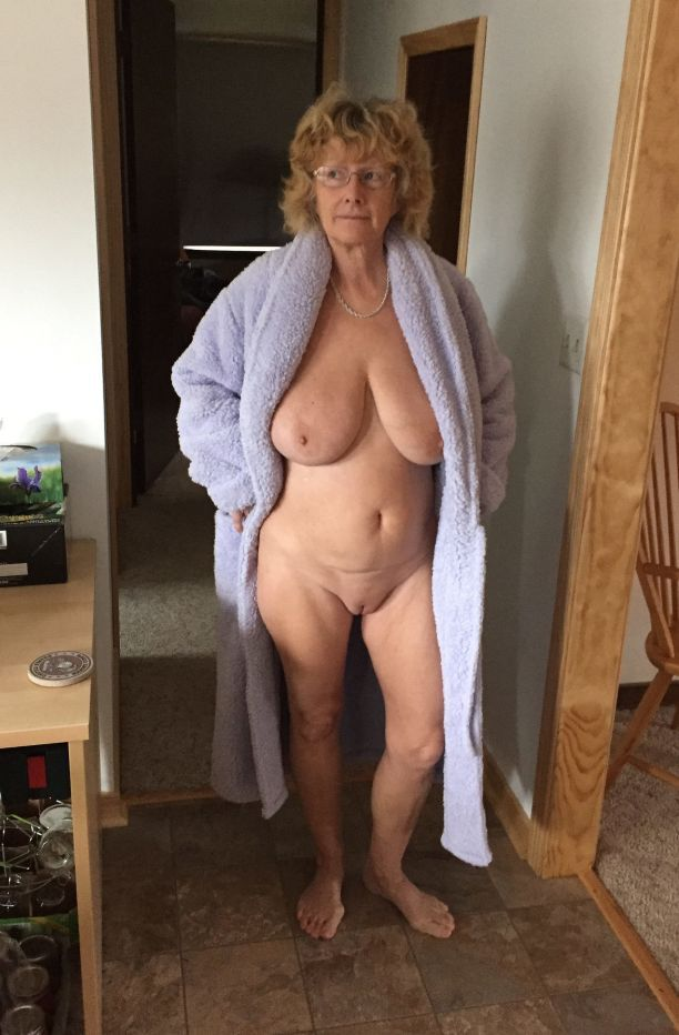 Average mature women posing topless