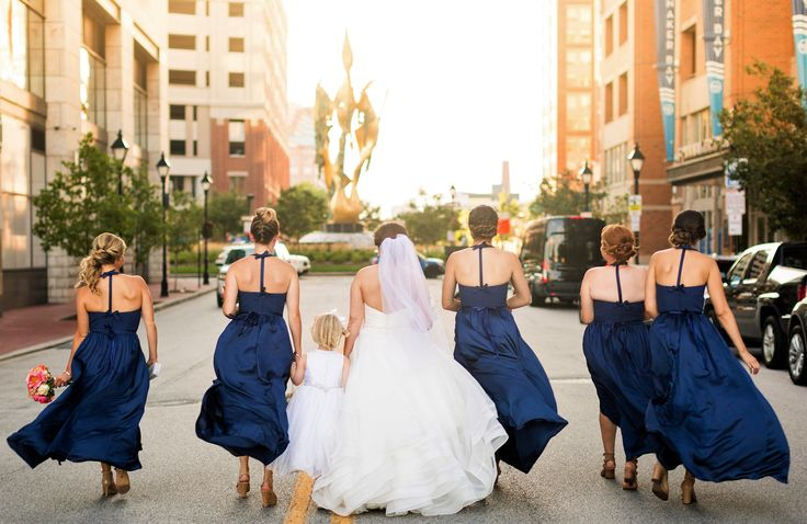 Bridal party looking beautiful outside Harbor Tower in Harbor East, Baltimore
