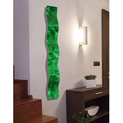 Green home décor is super cute and trendy especially green  wall art. Easily deck the walls of your  home with cute green wall clocks, green canvas art, and green metal art. Mix and match different textures to create  depth. You find all shades of green from emerald, lime, forest and even  Jade.       Emerald Green 3D Abstract Metal Wall Art Sculpture Wave - Modern Home Décor by Jon Allen - 46.5