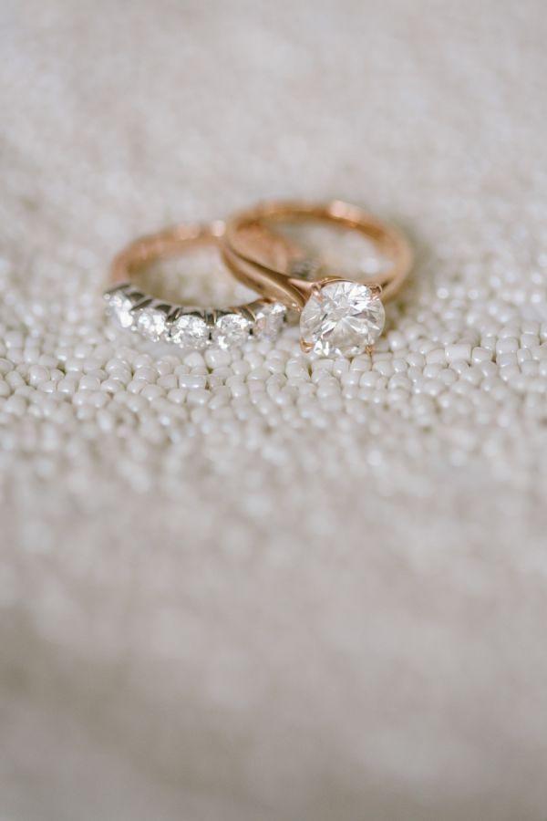 Pretty rose gold solitaire engagement ring + wedding band: http://www.stylemepretty.com/new-york-weddings/new-york-city/2016/01/19/wedding-photographer-says-i-do-in-new-york-city/ | Photography: Katie Kett - http://katiekettphotography.com/