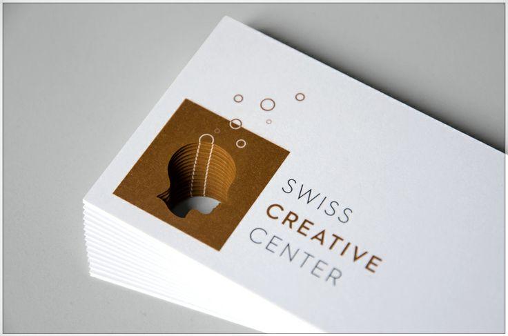 Swiss Creative Center | Carte de visite avec une impression Pantone cuivré et noir sur du papier Ispira Purezza avec découpe laser | by Contreforme