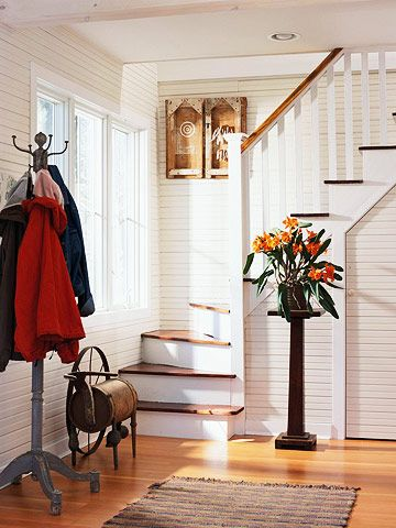 Inviting Entrance        This dynamic entry combines an old-fashioned coat rack, a simple Craftsman-style plant stand, and horizontally oriented beaded board
