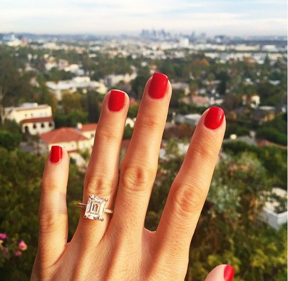 Geri Hirsch of Because I'm Addicted wears red nail polish with a square shaped diamond engagement ring