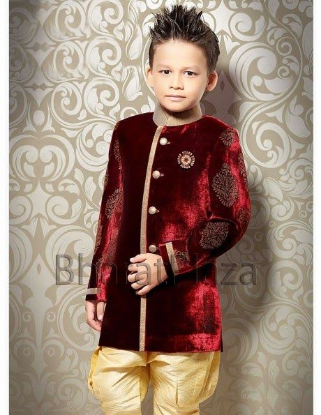 Pleasurable maroon color velvet Indo western Sherwani is having attractive block motifs on sleeves, high neck collar, golden piping on front panel and decorative brooch.