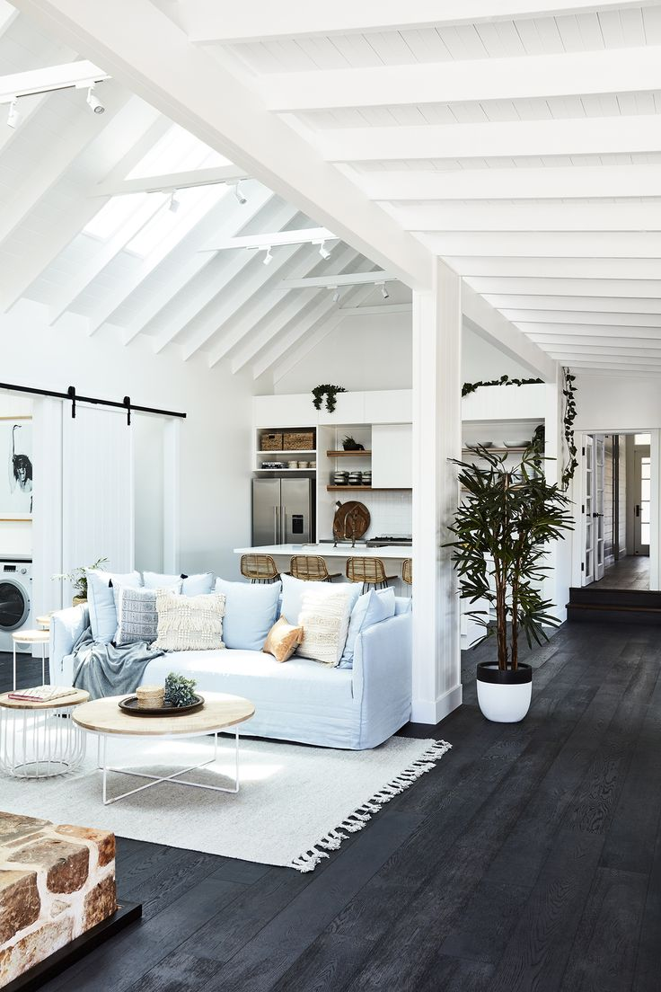 Adore Magazine | Farmhouse with Soul | Open Living Room with Powder Blue Couch - pinned by www.youngandmerri.com