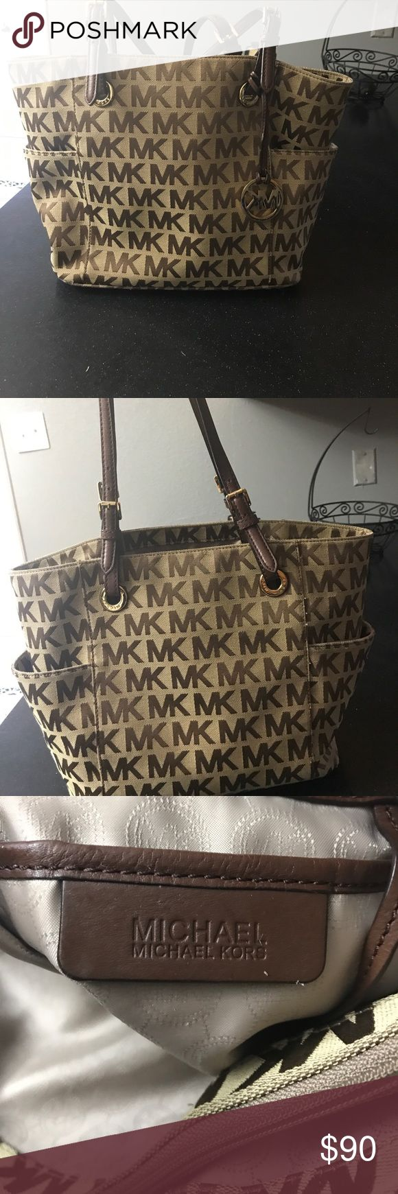 Michael kors purse Michael kors purse brown with gold. A few stains on the inside but that's all. Michael Kors Bags Totes