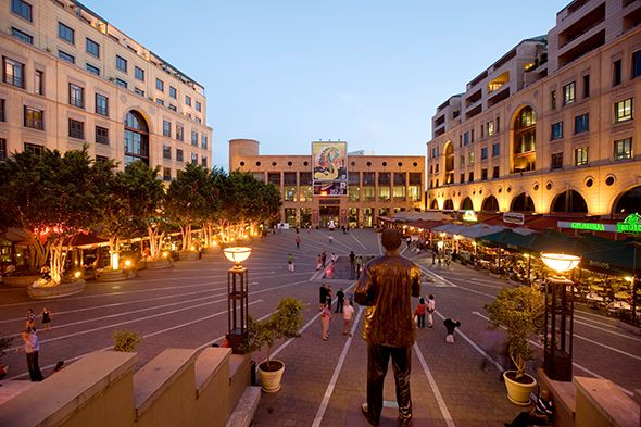 Nelson Mandela Square at dusk in Sandton, Johannesburg (Photograph by David Buzzard, Alamy)