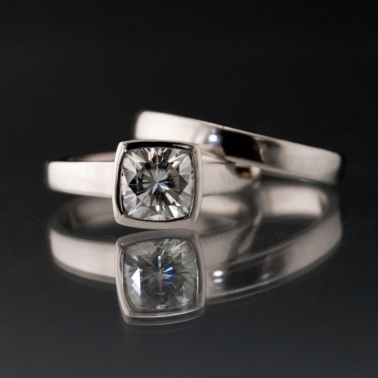 Moissanite Bezel Set Cushion Engagement Ring and Wedding Band Bridal Set in Silver/Palladium.