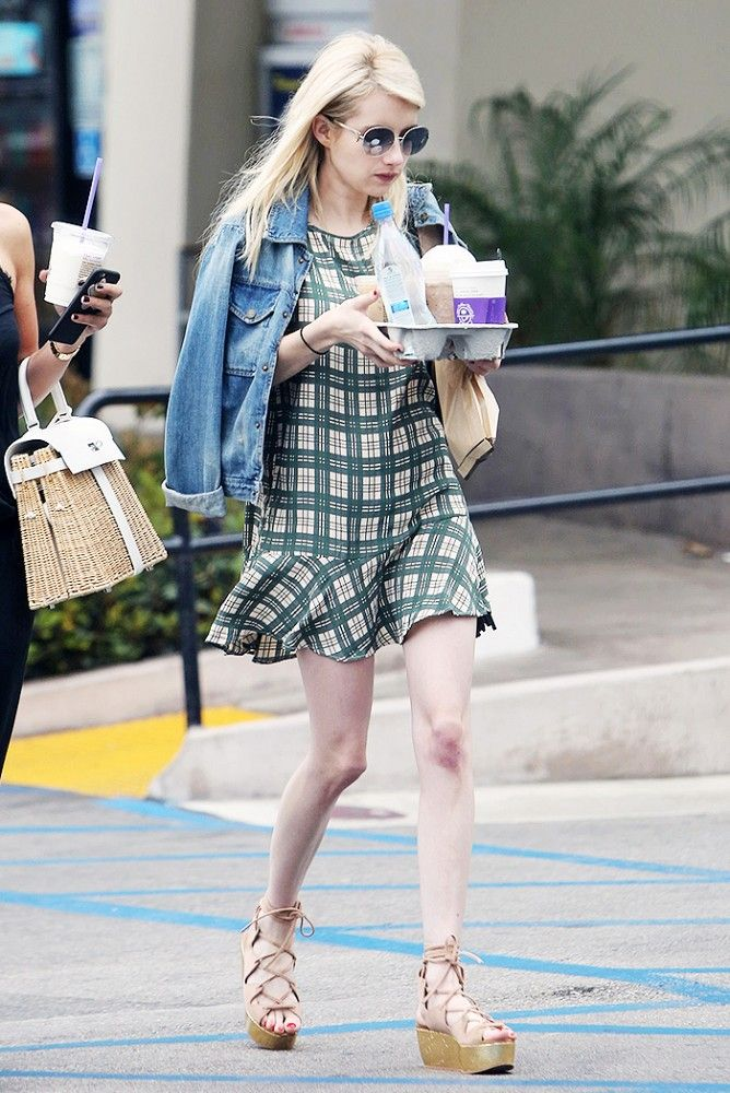 Emma Roberts in Fall 2015 plaid Elkin dress, denim jacket, and See by Chloe sandals