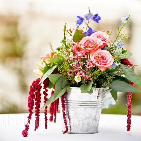 wildflowers, tiny roses and amaranthus in small galvanized pails.
