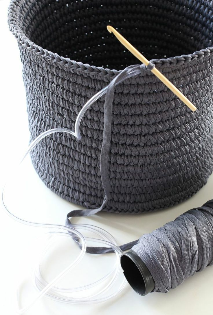 Crochet basket made with tape yarn over plastic tubing