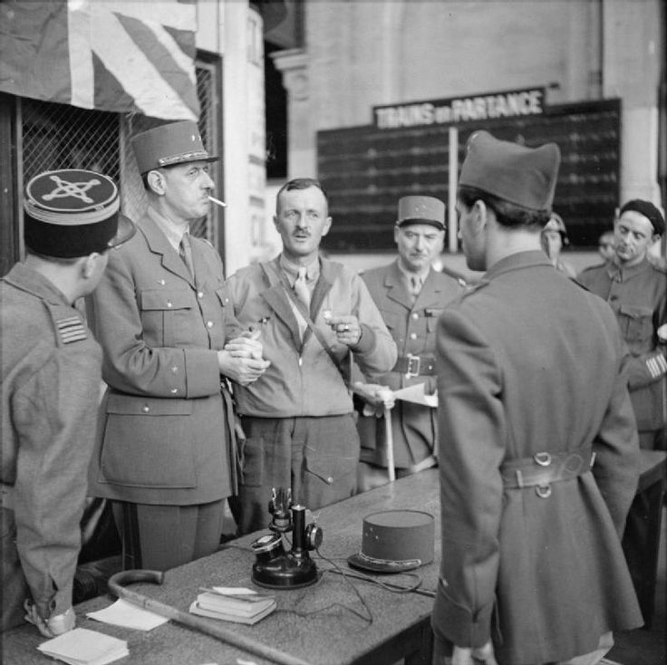 General De Gaulle with General Leclerc and other French officers at Montparnasse railway station in Paris, 25 August 1944.