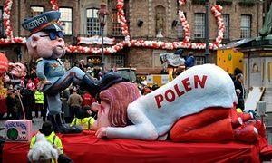 A carnival float depicting the chairman of the Law and Justice party, Jarosław Kaczyński, oppressing Poland.