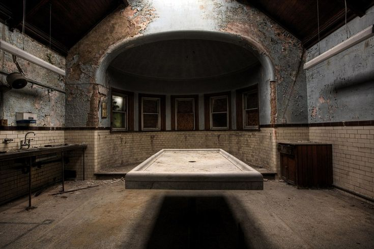 Afterlife: An abandoned room rots away at West Riding Pauper Lunatic Asylum at High Royds Hospital in Menston, West Yorkshire.