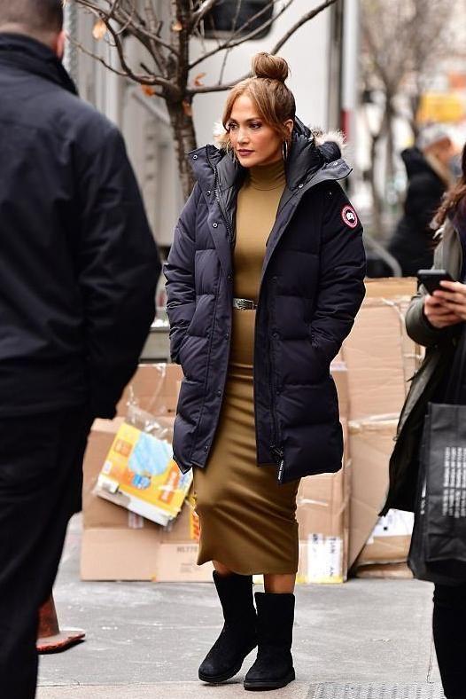 Jennifer Lopez wearing Canada Goose Shelburne Parka and Ugg Amie Boots