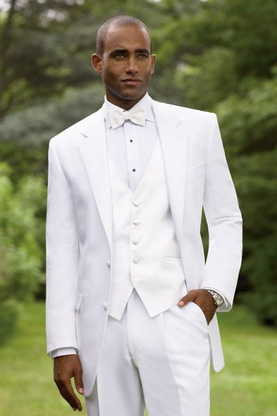 Classic look, perfect for summer formal weddings! Calvin Klein White Newport from Geno's Formal Affair, available at Rebecca's Black Tie www.rebeccasweddings.com