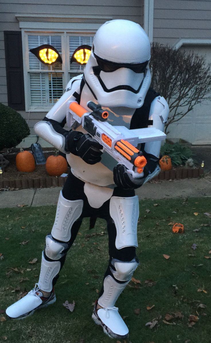 Storm Trooper Costume:  SEE COMMENTS FOR INSTRUCTIONS. 3 sets soccer shin guards. 2 rollerblade knee pads. 2 rollerblade elbow pads. 1 chest pad. 1 2 liter plastic bottle. 1 roll white foamy shelf liner. 1 can white gloss spray paint. Double stick tape Velcro tape. purchased helmet.