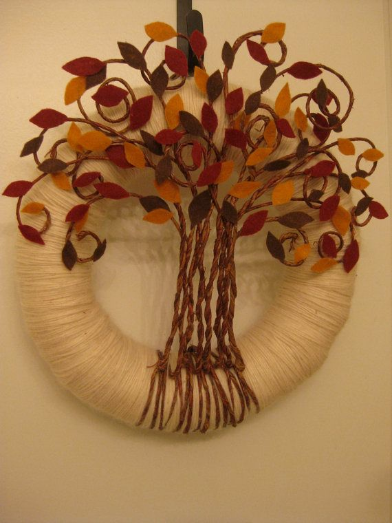 Nice Fall Wreath. Made from a straw wreath, textured wire and different shades of brown and gold felt. Beautiful!