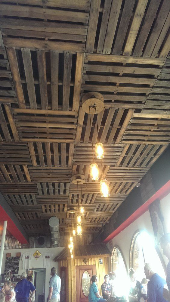 Sno Town Brewery - Snohomish, WA, United States. Pallet ceilings with Mason jar & Edison bulb pendant lighting