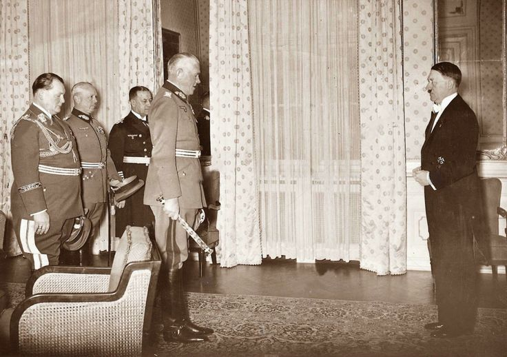 January 11, 1938, at the home of the Reich President in the Wilhelmstrasse in Berlin. Hitler, in tails, receives the heads of the Armed Forces as the Supreme German Army Commander at the New Year reception. War Minister Field Marshal Werner von Blomberg appears as Commander of the Armed Forces, then Goering represents the Luftwaffe, von Fritsch the Heer, and Admiral Erich Raeder for the Kriegsmarine.  Hitler's tails trump the boys' brocade belts.