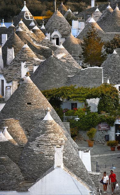 Alberobello, Puglia, Italy. Alberobello is a small town and comune in the province of Bari, in Puglia, Italy. It has about 11,000 inhabitants and is famous for its unique trulli constructions. A Trullo is a traditional Apulian dry stone hut with a conical roof. Their style of construction is specific to the Itria Valley, in the Murge area of the Italian region of Apulia.