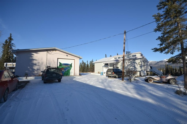 $795,500 MacRae 5 Glacier Road – MLS 8114 1978 – 2400 sq ft finished country residential home, 4 bed 3 bath,  over 1 acre lot with Grey Mountain views, mixed zoned commercial industrial and residential, large 40 x 60 ft workshop, 60 sq ft potential in-law suite, upper level walkout deck approx. 49 x 13 ft. brand new furnace and new oil tank.
