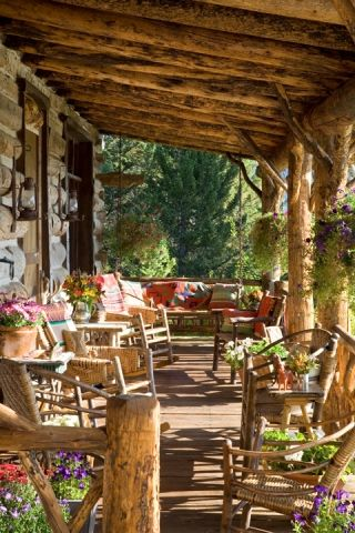 Love this rustic log cabin porch! So peaceful.