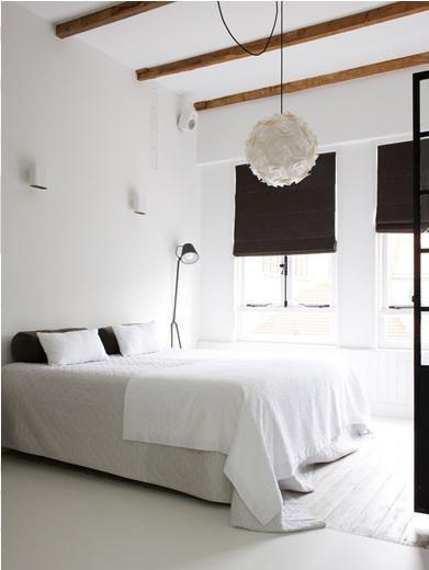 White bedroom. Photo by Marjon Hoogervorst