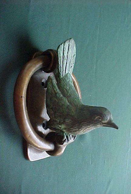 **Celadon bird door knocker on a blue door.