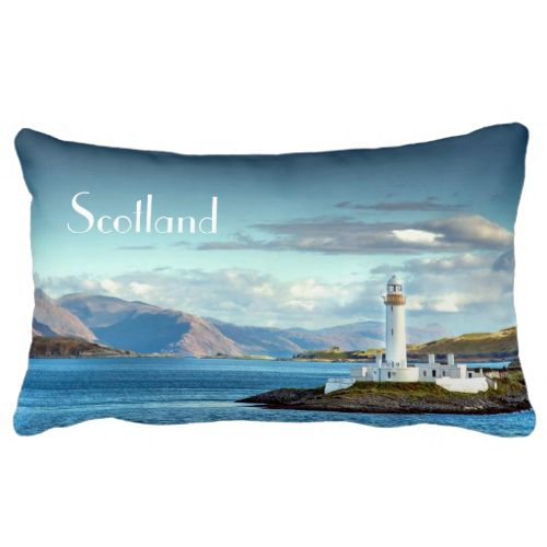 A beautiful view of hills, mountains, water and a lighthouse; from an original photograph taken on the Caledonia Macbrayne Ferry sailing from Oban in Scotland to The Isle of Mull. A fabulous home decor accessory lumbar pillow. #scotland #scottish #scenic #scenery #mountains #light-house #nature #blue #oban #mull #united-kingdom #statement-piece