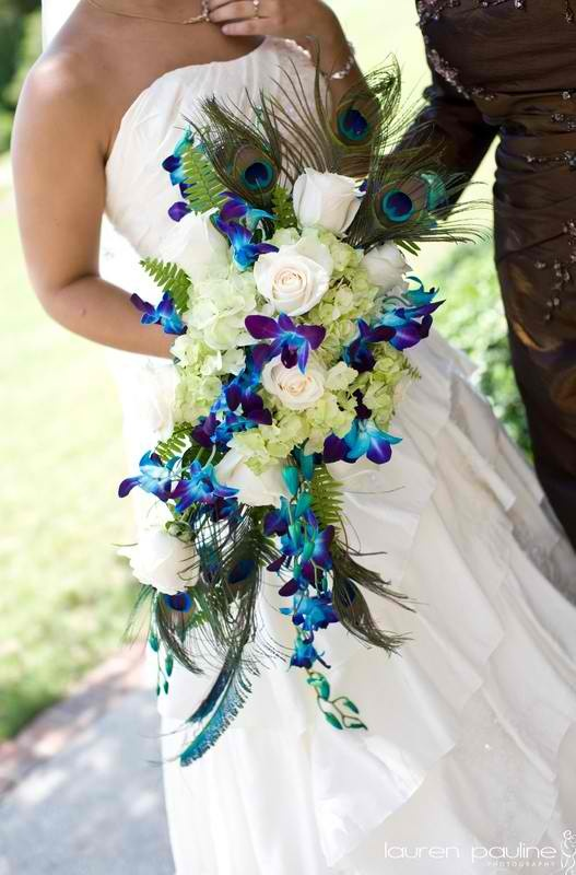 I saw this and it is my insperation for my wedding peacock feathers. Using marine blue, forest green and viola purple. <3<3<3