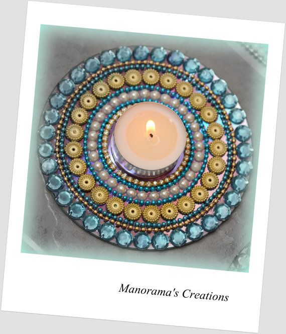 Floor Art Innovative Kundan Rangoli Design by ManoramasJewellery