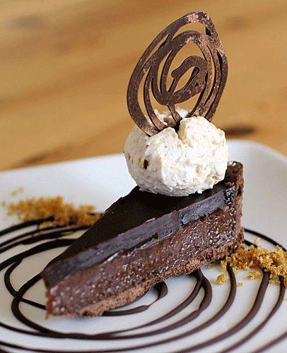 Chocolate pecan praline tart, served with praline cream.