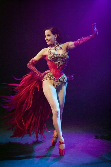 I love this picture as It declares how outrageous and extreme Burlesque is; also with Dita-Von Teese embracing her sexuality and femininity. The feathers make the costume more prominent. I love all the Glitter, sleek updo's, big lashes and corsets.