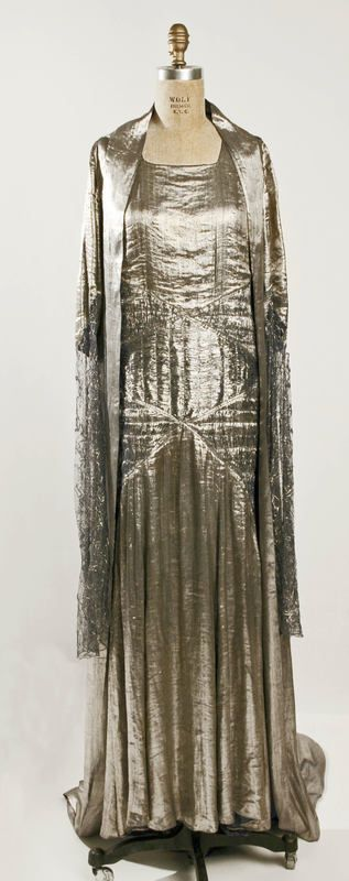 A 1930 silver lamé evening ensemble by Lanvin showing the long straight lines of the early 1930s.