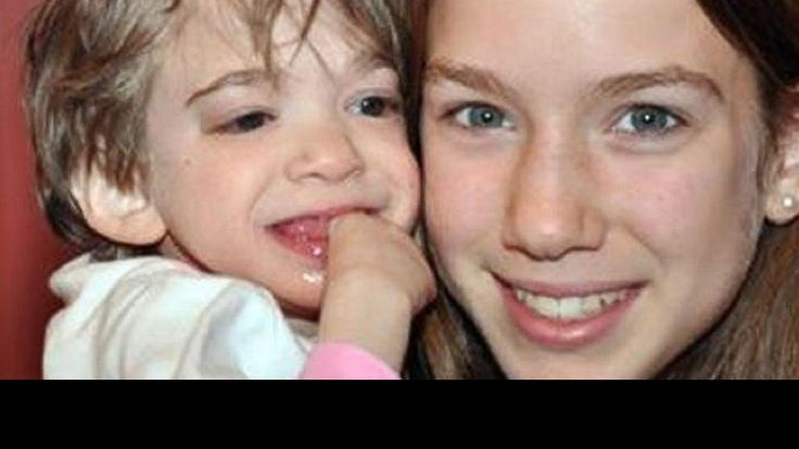 Brooke Greenberg, who baffled scientists because she never aged, has died at the age of 20, never having developed beyond the physical size of an infant or the mental capacity of a 2-year-old.    Precious face!