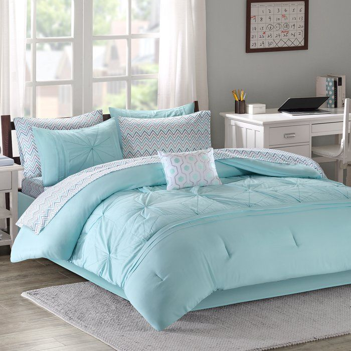This Comforter Set flaunts a casual elegance to glamorize your space. Alluring pleats with embroidery adorn the top of the soft gray comforter, adding beautiful texture and dimension to the bedding set. Stylish shams display a similar pleated design and embroidered detailing seen on the comforter for a fully coordinated look. The colorful chevron sheet set features blue, gray, and pink hues on a white ground to add a fun splash of color and style. A gorgeous decorative pillow further…