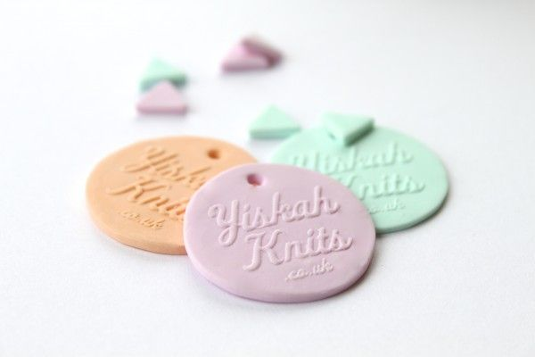 DIY Polymer Clay Tags. Any sort of picture stamp would make a cute handmade gift tag. You could use an alphabet set to write a message or go freehand.